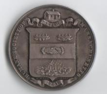 The front of the medal awarded to Captain James.