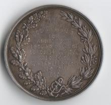 The back of the medal awarded to Captain James.