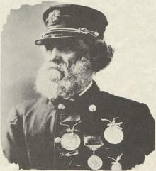 Black-and-white photo of Captain Joshua James in uniform with medals